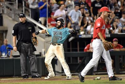 Coastal Carolina's Anthony Marks celebrates after scoring on a Connor Owings single as Arizona pitcher Cameron Ming (47) walks back to the mound in the eighth inning in Game 2 of the NCAA Men's College World Series finals baseball game in Omaha, Neb., Tuesday, June 28, 2016. (AP Photo/Ted Kirk)