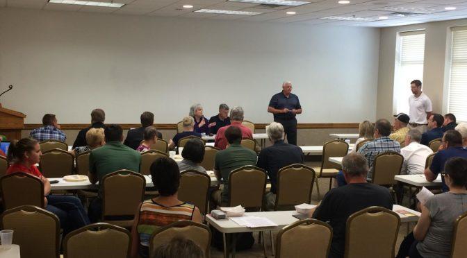 Front of the room: from left.   Lynn Hayes, Mike Weaver, John Hansen (standing), NE Farmers Union Pres.