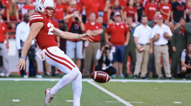 Courtesy/AP. Nebraska punter Sam Foltz (27) punts during the second half of an NCAA college football game against Wisconsin in Lincoln, Neb., Saturday, Oct. 10, 2015. Wisconsin won 23-21. (AP Photo/Nati Harnik)