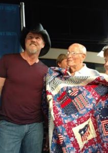 Quilts of Valor presentation to George Spencer of Hastings before Trace Adkins concert