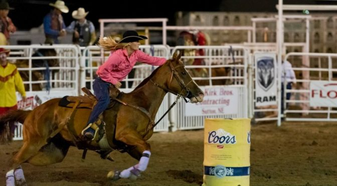 A cowgirl rounds a barrel at the 2013 Oregon Trail Rodeo. This year's rodeo is August 26-28 at the Adams Co. Fairgrounds in Hastings. Photo by Jorn Olsen.
