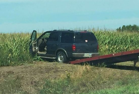 Courtesy/Robin Butzke. The stolen a blue Ford Expedition being towed from the cornfield where the suspects abandoned it, before fleeing into the field.