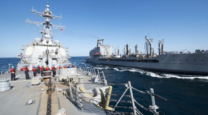 In this Thursday, Dec. 24, 2015 photo released by the U.S. Navy, guided-missile destroyer USS Bulkeley participates in a replenishment-at-sea with fleet replenishment oiler USNS John Lenthall in the Gulf of Oman. Iranian naval vessels conducted rocket tests last week near the USS Harry S. Truman aircraft carrier, the USS Bulkeley destroyer and a French frigate, the FS Provence, and commercial traffic passing through the Strait of Hormuz, the American military said Wednesday, Dec. 30, 2015 causing new tension between the two nations after a landmark nuclear deal. (Mass Communication Specialist 2nd Class M. J. Lieberknecht/ U.S. Navy via AP)