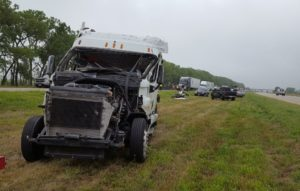 Semi-driver injured in rollover east of Overton