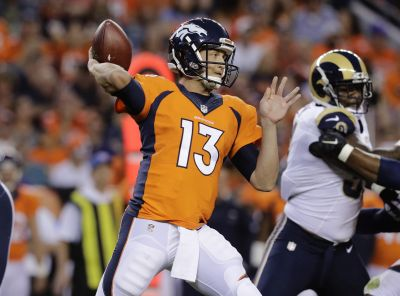 Denver Broncos quarterback Trevor Siemian (13) looks to throw against the Los Angeles Rams during the first half of an NFL preseason football game, Saturday, Aug. 27, 2016, in Denver. (AP Photo/Joe Mahoney)