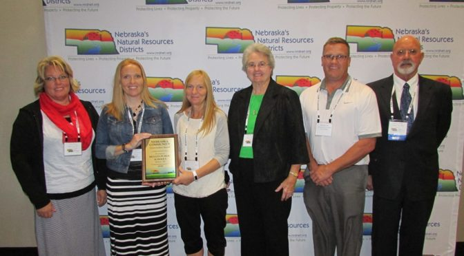 (L to R) Community Conservation award includes:  Anna Baum – General Manager of Upper Loup NRD  Sarah Hardin – Mullen Public Schools  Roxann Brown - Mullen Public Schools  Judy Ridenour – Nebraska Association of Resources Districts Board member  Mike Kvanvig - Mullen Public Schools  Jim Bendfeldt - Nebraska Association of Resources Districts President