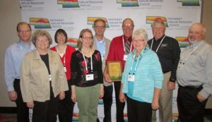 (L to R) Director of the Year award includes: Andy Hadenfeldt – Family Nancy Hadenfeldt – Family Joan Larson – Family Brenda Hadenfeldt – Family Michael Greer – Family Richard Hadenfeldt – Award Winner Jan Hadenfeldt – Richard's wife Leon (Butch) Koehlmoos – General Manager of Lower Loup NRD Jim Eschliman – Board member of Lower Loup NRD