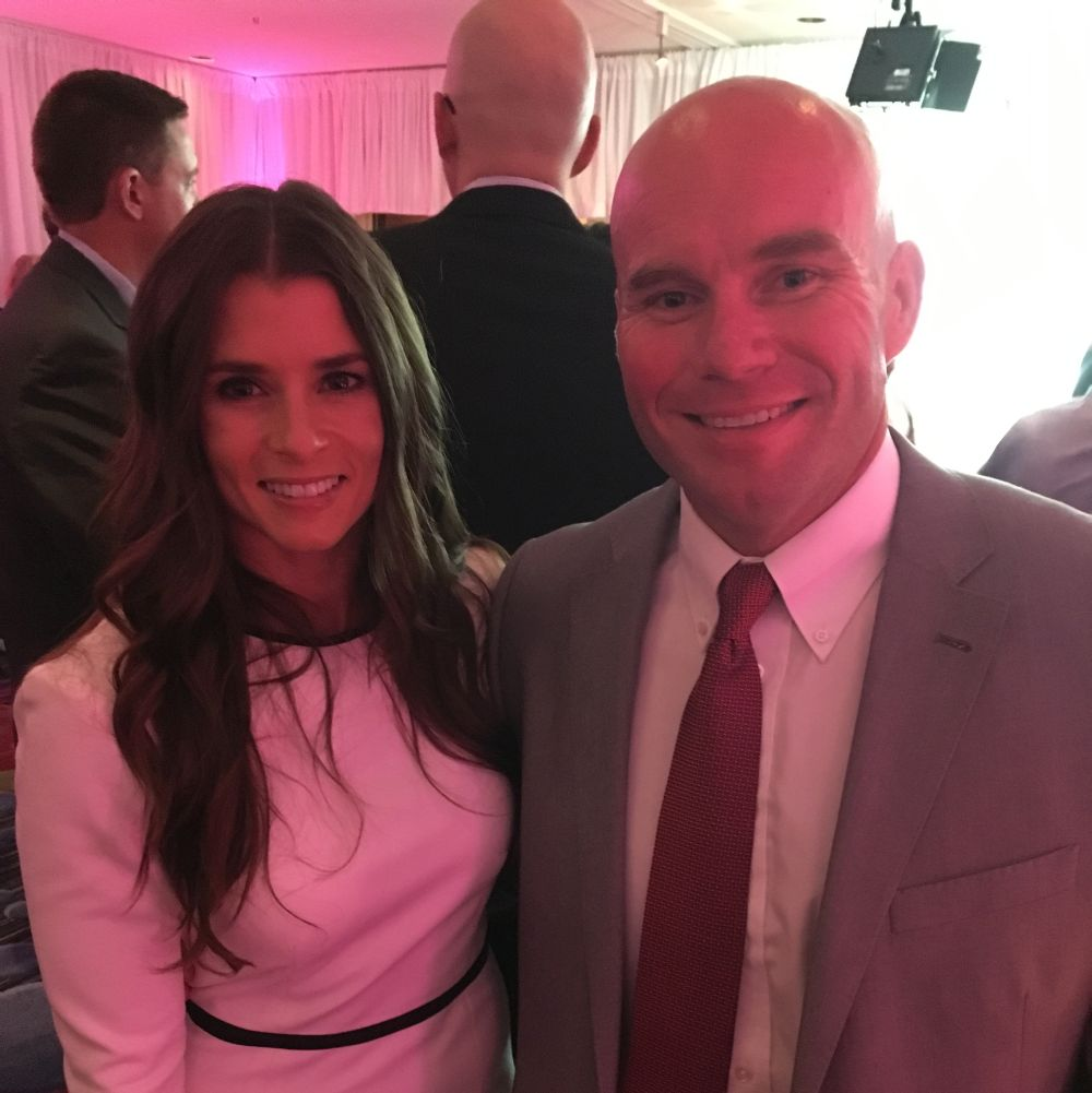 Courtesy/ Team Jack Foundation.  Andy Hoffman with NASCAR Driver Danica Patrick.