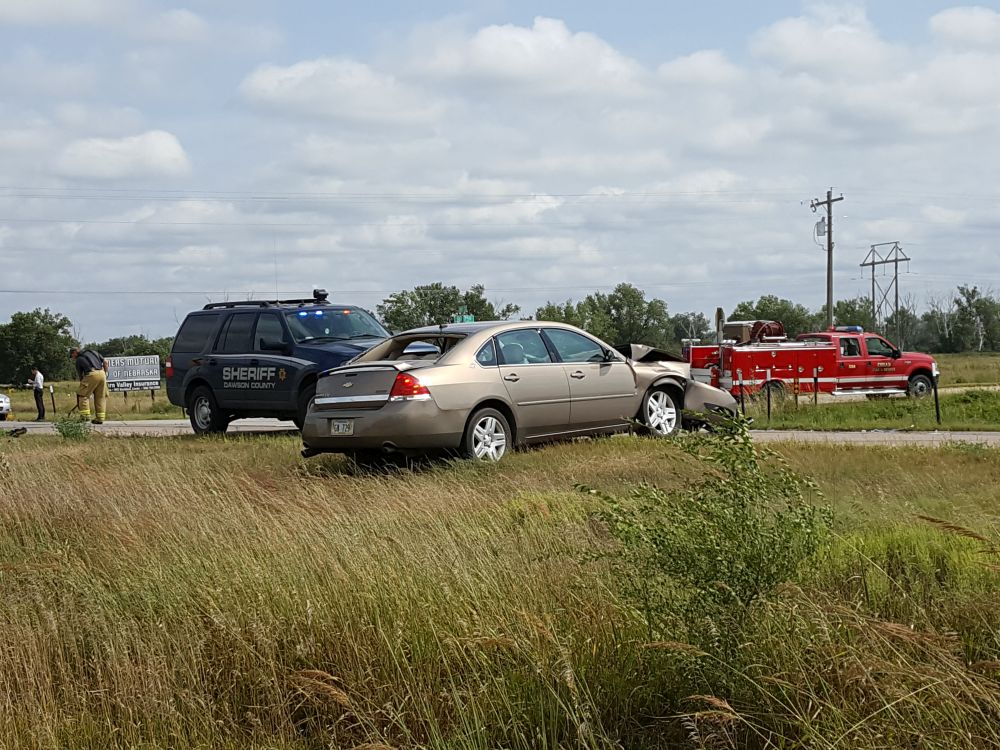 RRN/ Car in foreground was one of two vehicles involved in a collision one mile south of Cozad Friday morning September 2, 2016 on Highway 21.