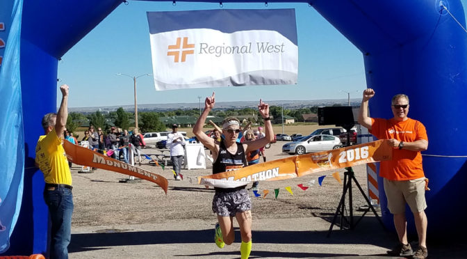 Nicholas Kizzire finishes first in the Monument Marathon Full race on Saturday, Sept. 24, at Five Rocks Amphitheater in Gering. / Chabella Guzman KNEB