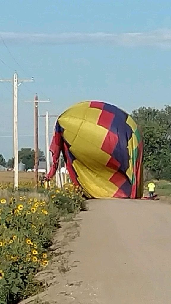 Hot air balloon contacts power lines after landing Sunday
