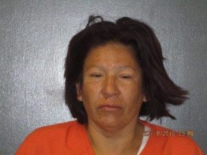 Bluffs woman arrested in box cutter attack