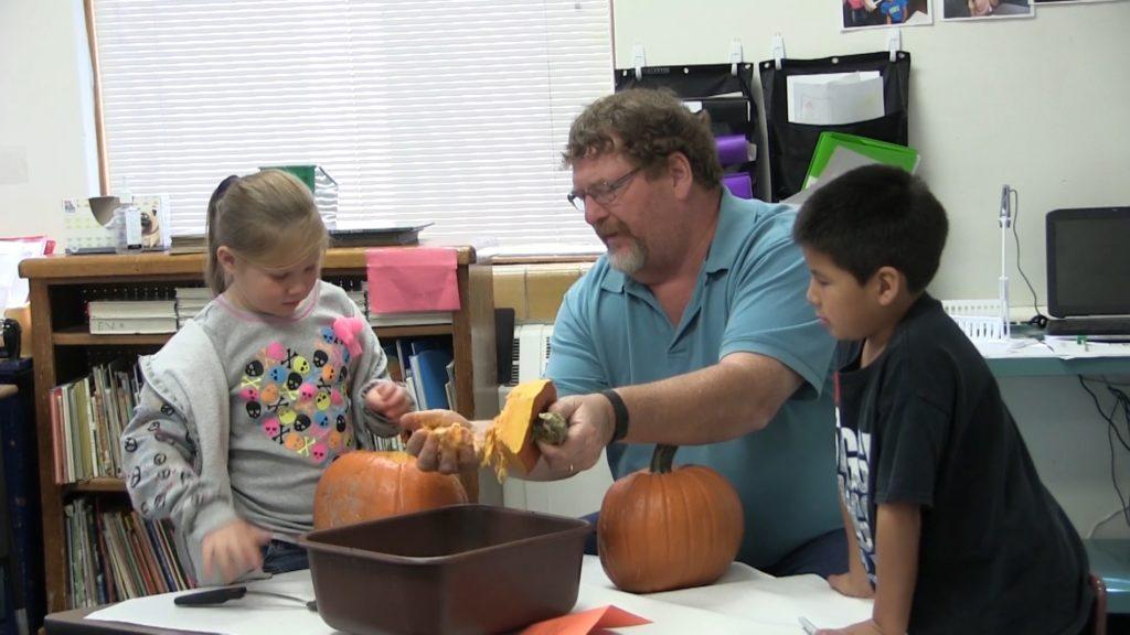 Dozens of volunteers help Roosevelt Elementary students with pumpkin carving