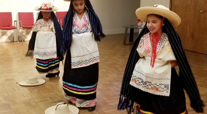 "The Guadalupanos Dancers, Camila Sanchez, left, Ami Perez and Ahria Aviles performing a traditional dance at the the presentation Wednesday ""Dancing with the Dead"" at the arts center. KNEB/Chabella Guzman"