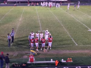 Scottsbluff and Sidney captains meet for coin toss Friday night.