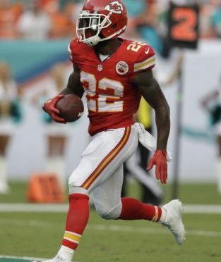 Kansas City Chiefs running back Joe McKnight (22) scores a touchdown during the second half of an NFL football game against the Miami Dolphins, Sunday, Sept. 21, 2014, in Miami Gardens, Fla. (AP Photo/Wilfredo Lee)