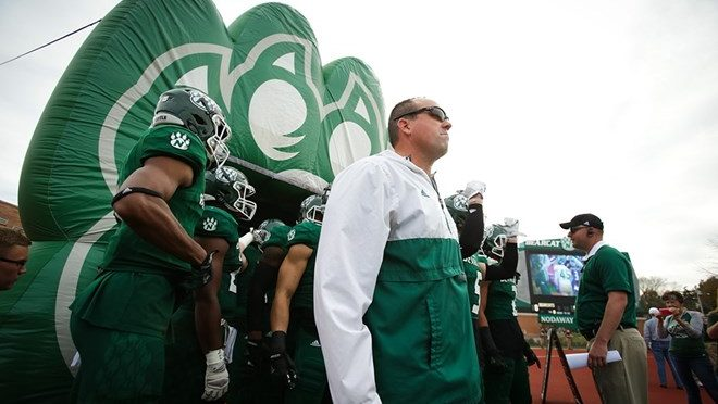 Northwest Missouri State University Head Football Coach Adam Dorrel prepares to lead his team out of the pre-game tunnel