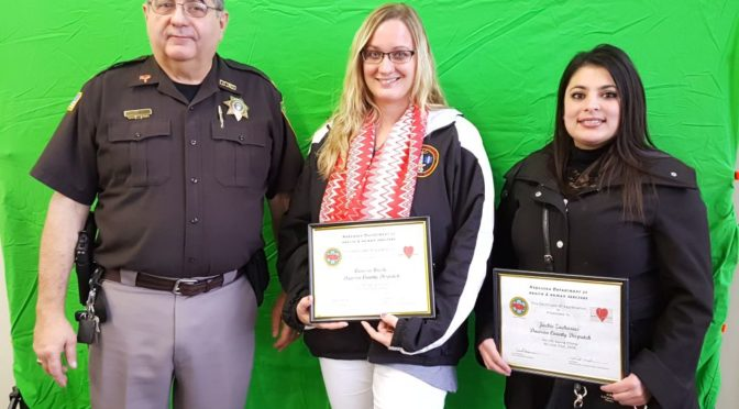 RRN/ Dawson County Sheriff Gary Reiber presents Life Saver Awards to Carissa Ureste(center) and Jackie Zacarias(right) on Monday December 5, 2016.