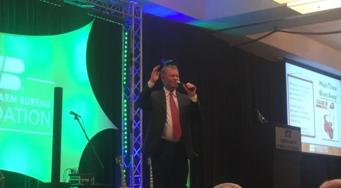 Rick Shoemaker owner of Huss Livestock Market &Lexington Livestock Market auctioneers the NEFB Foundation Grower's Gala.