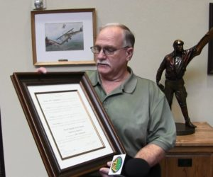 Outgoing Airport Authority member honored with plaque