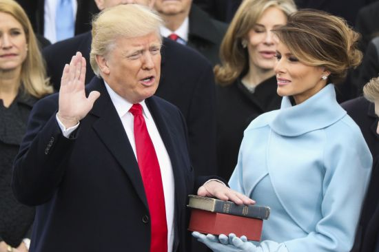 Courtesy/AP. Donald Trump is sworn in as the 45th president of the United States as Melania Trump looks on during the 58th Presidential Inauguration at the U.S. Capitol in Washington, Friday, Jan. 20, 2017. (AP Photo/Andrew Harnik)