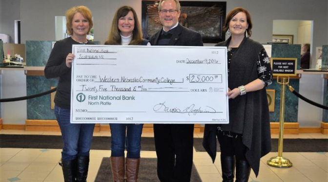 Pictured, from left to right, is Dawne Wolfe and Laurie Morgheim from First National Bank, and Dr. Todd Holcomb and Jennifer Rogers from WNCC.