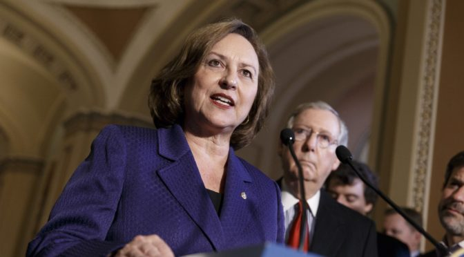 FILE - In this April 8, 2014 file photo, Sen. Deb Fischer, R-Neb., accompanied by Senate Minority Leader Mitch McConnell of Ky., talks during a news conference on Capitol Hill in Washington. While a host of prominent Republicans in Congress have jumped off the Donald Trump train, some of them are climbing back aboard after taking heat from loyalists of the controversial billionaire candidate. (AP Photo/J. Scott Applewhite, File)