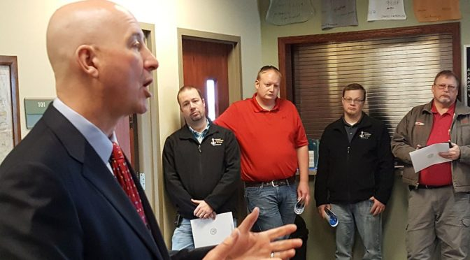 RRN/ Gov. Pete Ricketts speaks to group of people gathered at Lexington Airport on Wednesday January 19, 2017 as part of his state fly around following his delivery of the State of the State address last week.