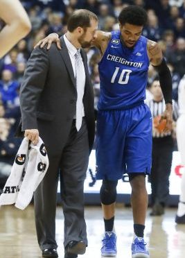 Creighton's Maurice Watson Jr. (10) is walked off the court after a knee injury in the first half of an NCAA college basketball game against Xavier, Monday, Jan. 16, 2017, in Cincinnati. Creighton won 72-67. (AP Photo/John Minchillo)
