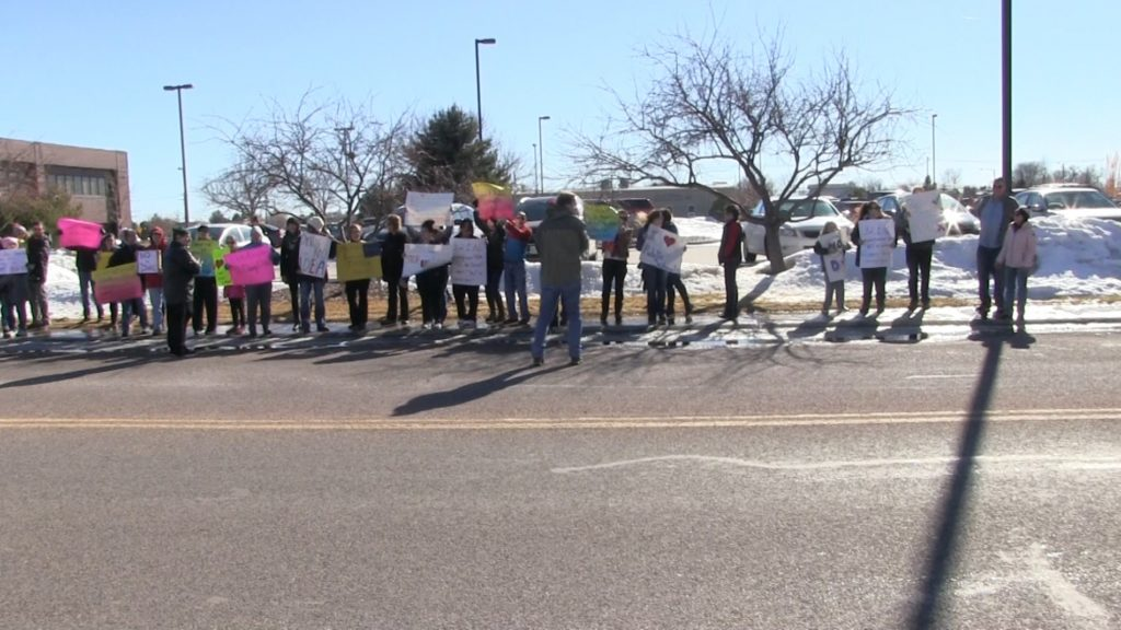 Dozens protest in front of Sen. Fischer's Scottsbluff office over Secretary of Education nominee