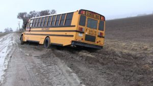 Two First Student buses slide off county roads; no injuries