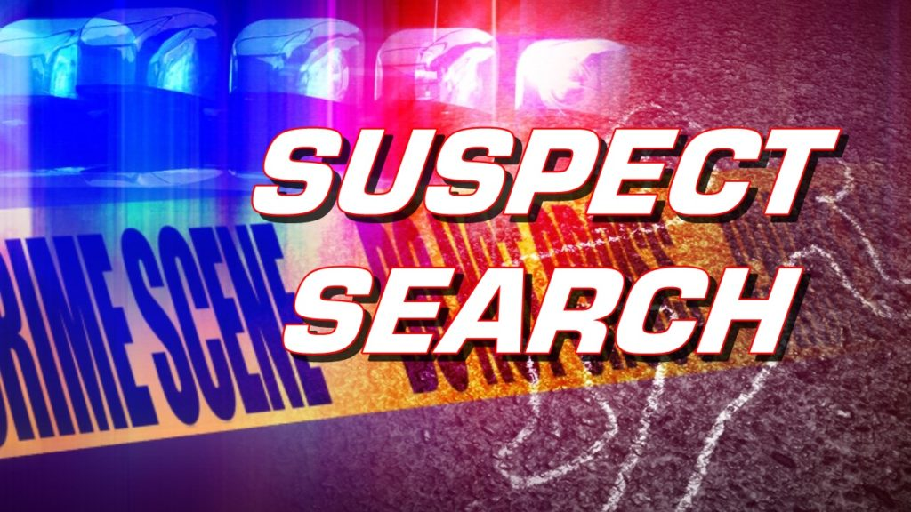 Law enforcement hunt for two armed suspects