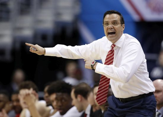 No injuries when pickup strikes SUV of Huskers' coach Miles