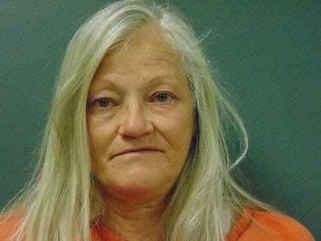 Woman arrested after dropping purse with meth in it