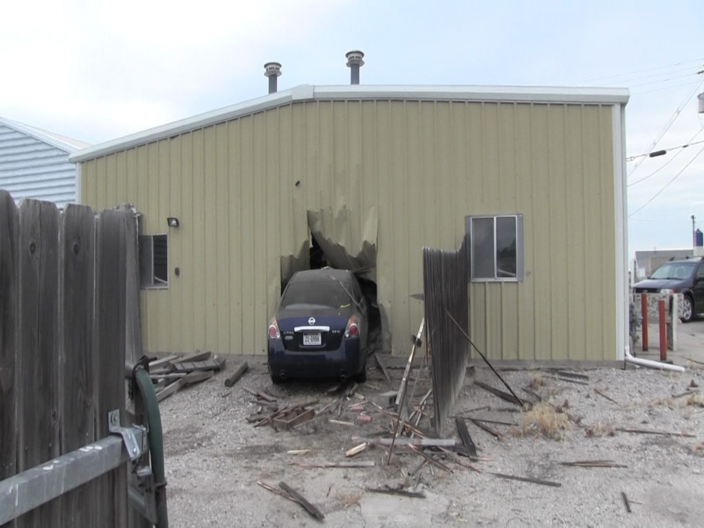 Gering woman crashes car into building