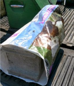 Cinder block filled bags intentionally left on roads