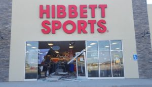 Hurtling car smashes storefront doors, suspect arrested