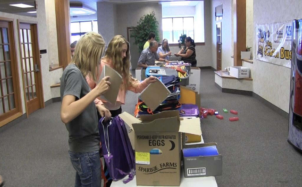 Stuff The Bus volunteers sort fewer donations this year
