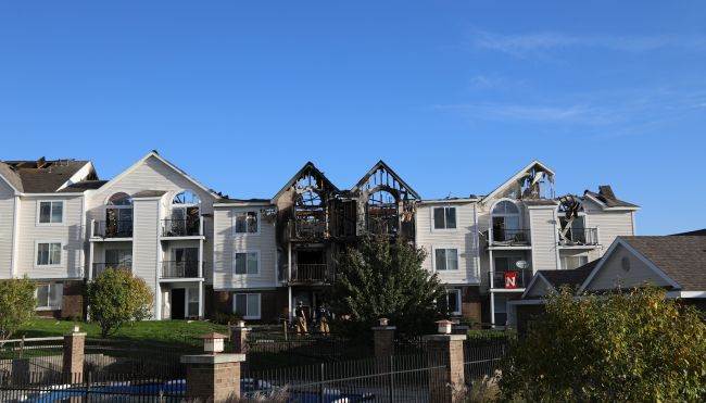 Firefighters: Tossed cigarette likely caused apartment blaze