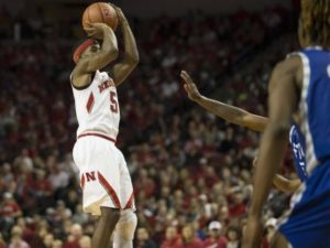 NU Men Hold On For Win