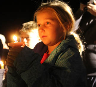 George And Susie Loofe >> Josslyn Hoefer holds a candle during Sunday's vigil at the Neligh-Oakdale football field to pray ...