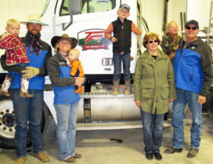 Family and individual recognized for service to ag and service to extension
