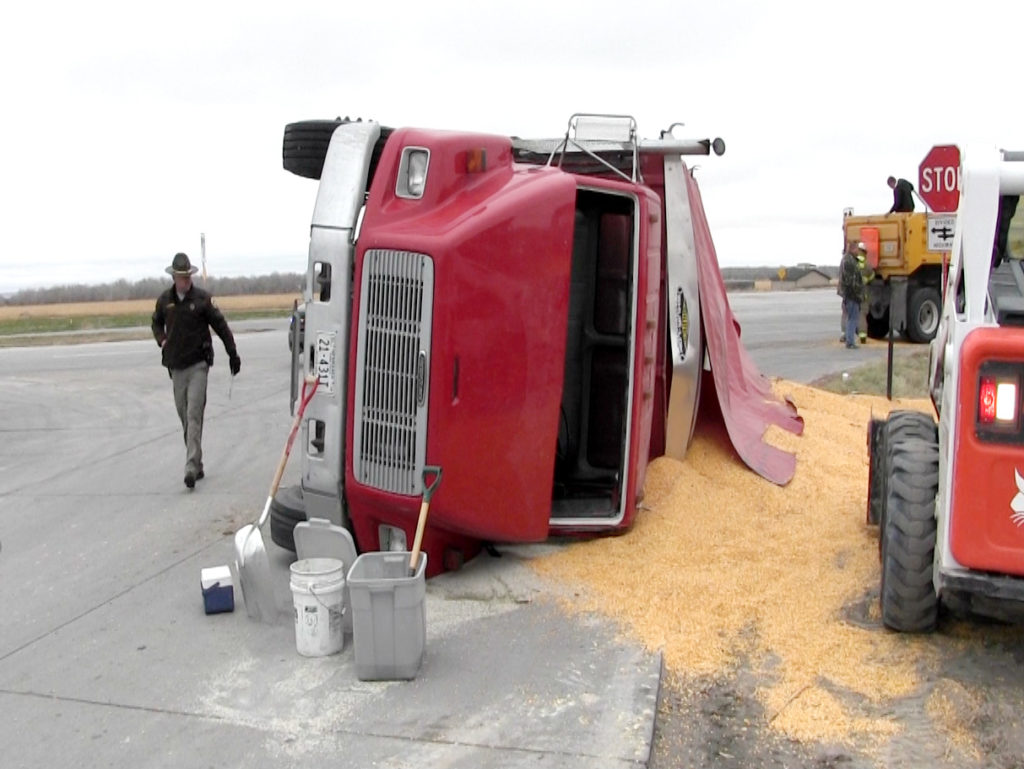 Grain truck tips over at Hwy 71 Bypass intersection