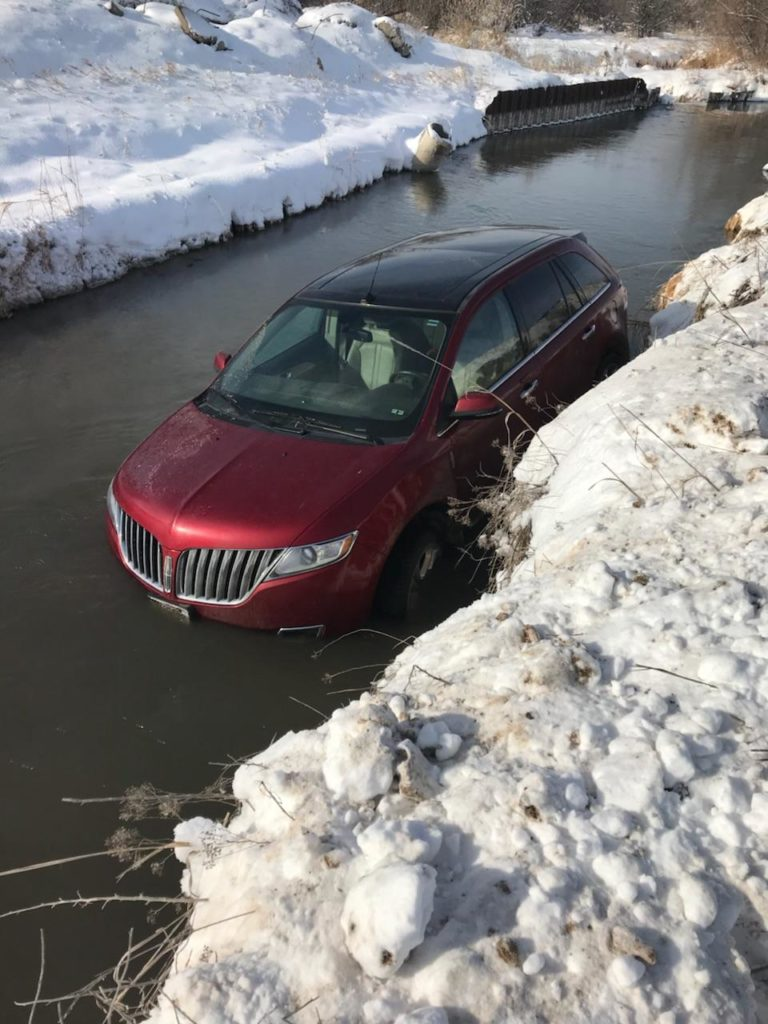 No one injured as vehicle slides into Nine Mile Creek