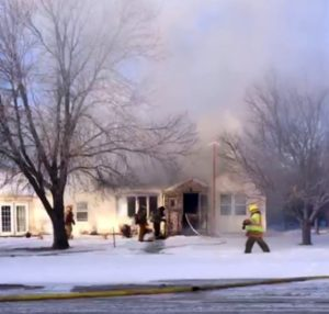 Firefighters respond to fully engulfed Morrill house fire