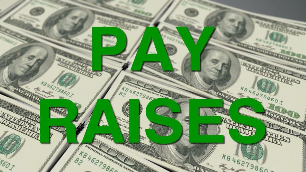 Commissioners approve substantial pay hikes for themselves, others