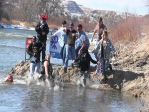 Dozens of plungers brave freezing cold temperatures