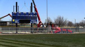 Scoreboard installation shows Pioneer baseball right around the corner