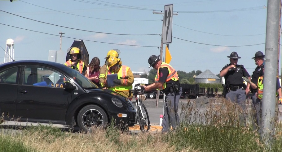 Bicyclist suffers minor injuries on Highway 26 after being struck by car