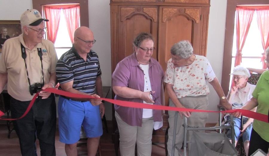 Gentry Log Cabin home celebrates grand opening